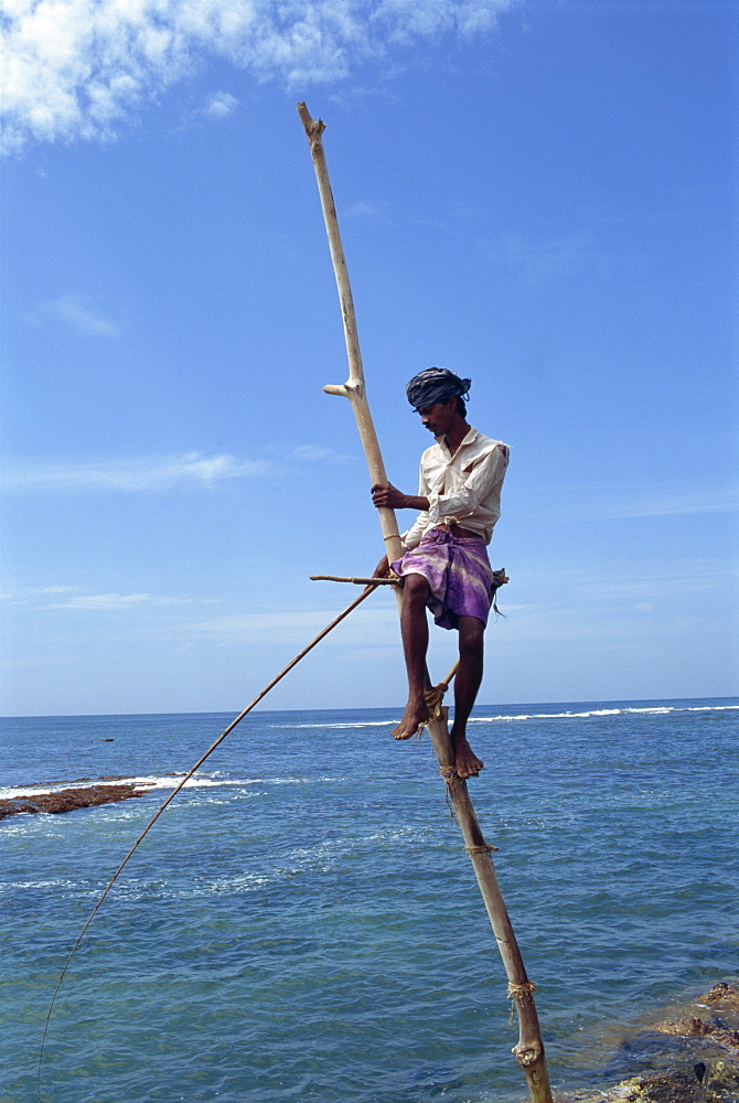 Stilt fisherman, near Galle, Sri Lanka, Asia