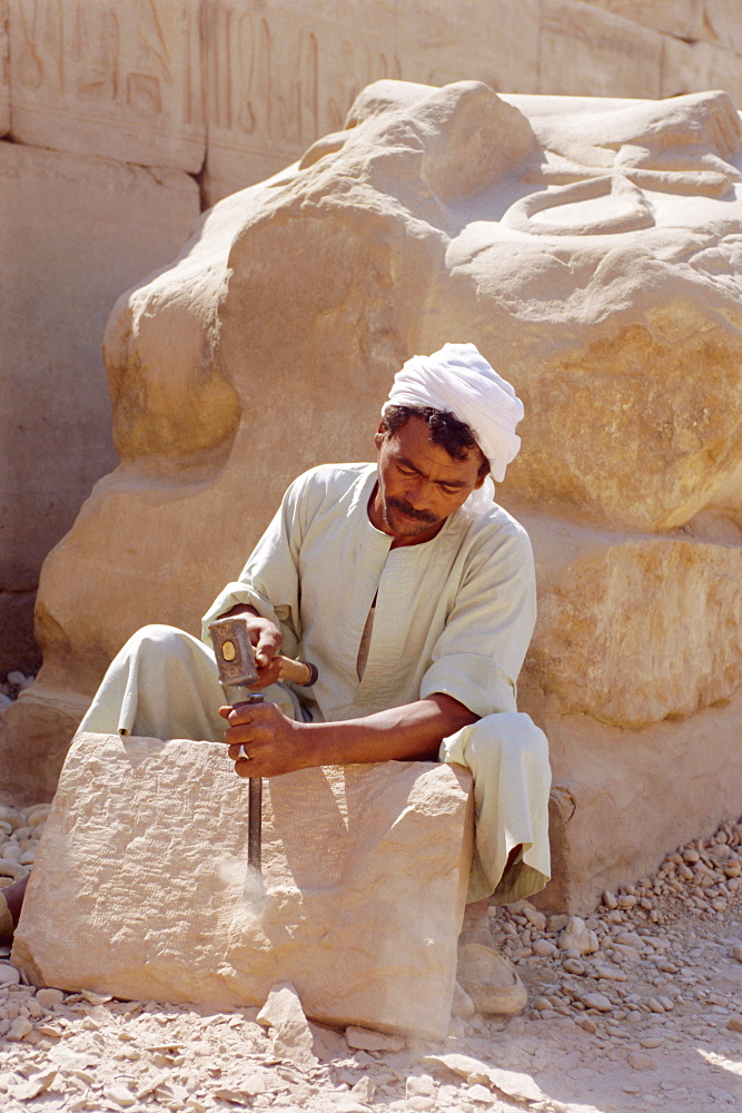 Stone mason at Temple of Karnak, Egypt, North Africa
