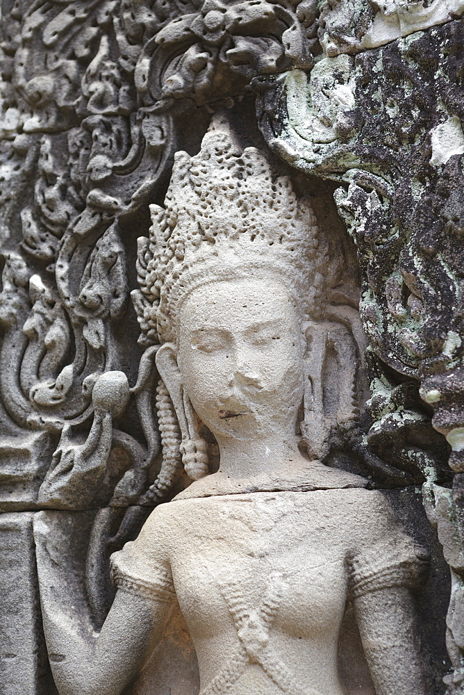 A crumbling carving in stone, Bayon, Angkor, UNESCO World Heritage Site, Siem Reap, Cambodia, Indochina, Southeast Asia, Asia