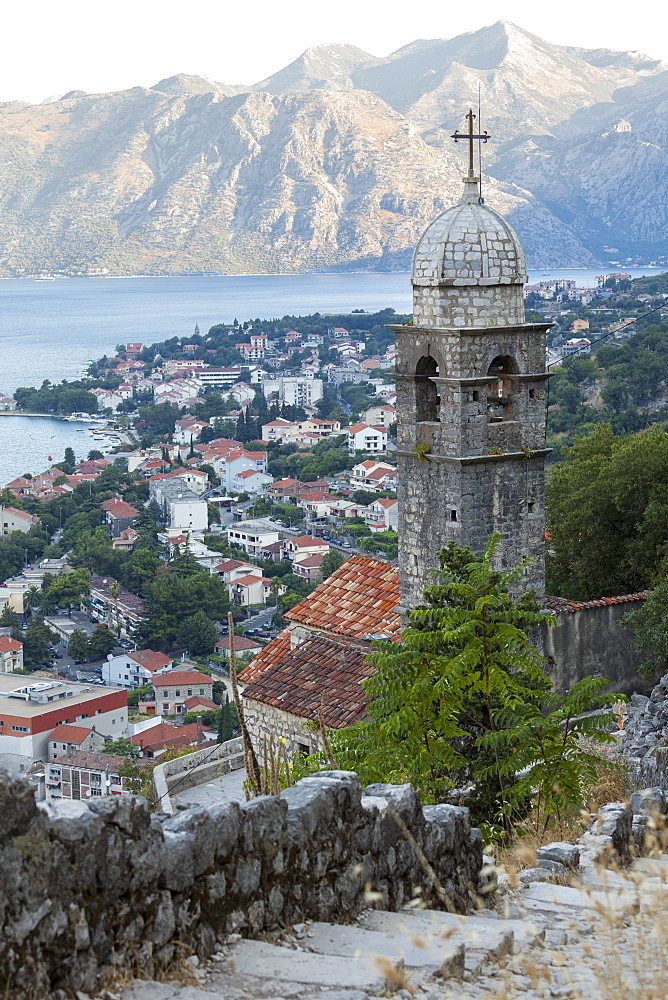 Kotor Old Town and fortifications at dawn with the Church of our Lady of Remedy in the foreground, Bay of Kotor, UNESCO World Heritage Site, Montenegro, Europe