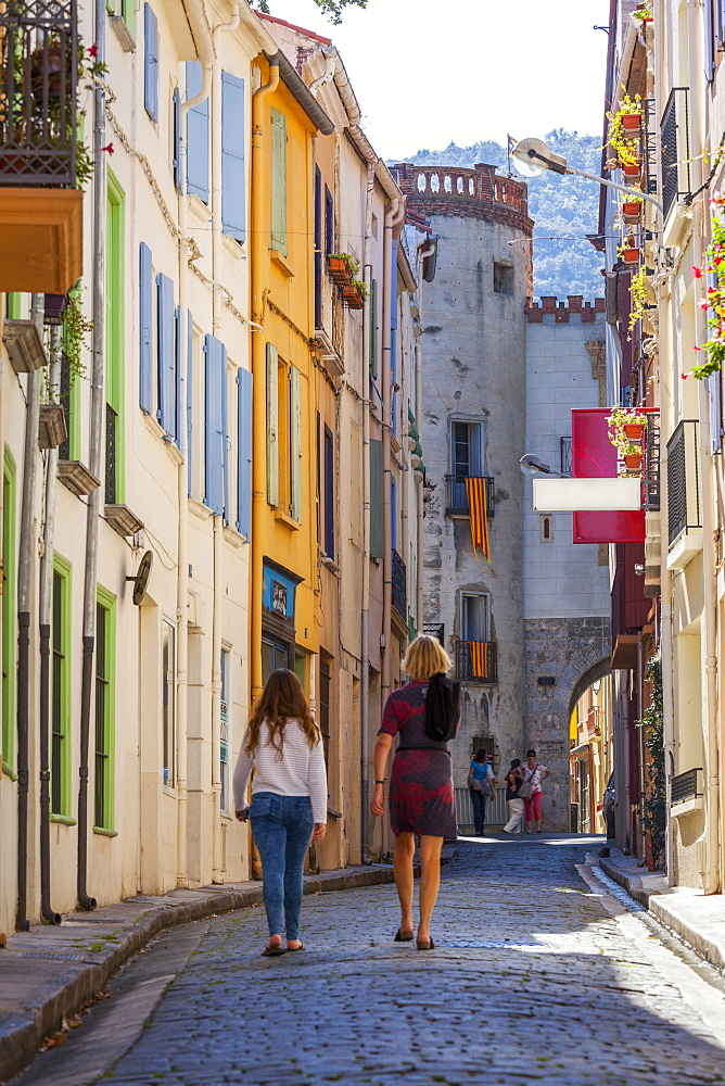Two women walking towards the old town, Ceret, Vallespir region, Pyrenees, France, Europe - 10-435