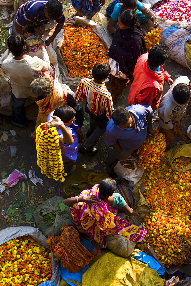 Traders sell ceremonial flowers at the Kolkata Flower Market, West Bengal, India - 1005-37