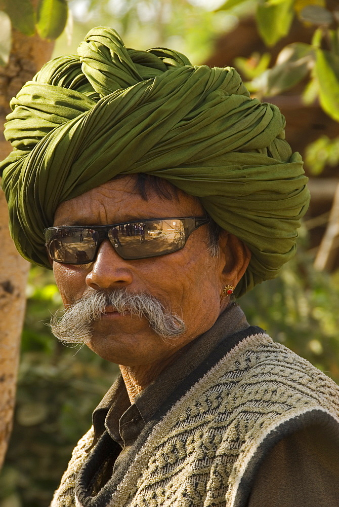 Portrait of elderly man in sunglasses and turban, Udaipur, Rajasthan, India