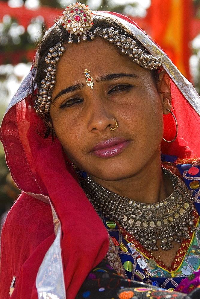 Portrait of young Rajasthani woman dressed for traditional dance, Rajasthan, India