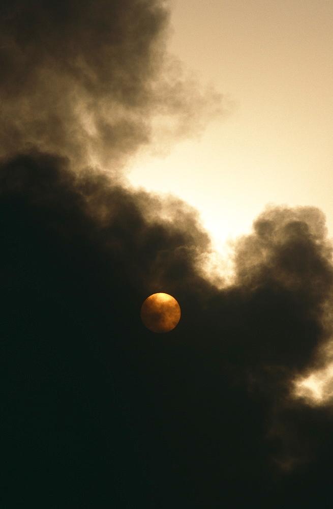 Smoke covering sun from oil refindery on fire.  Island in Arabian Gulf - 1036-253