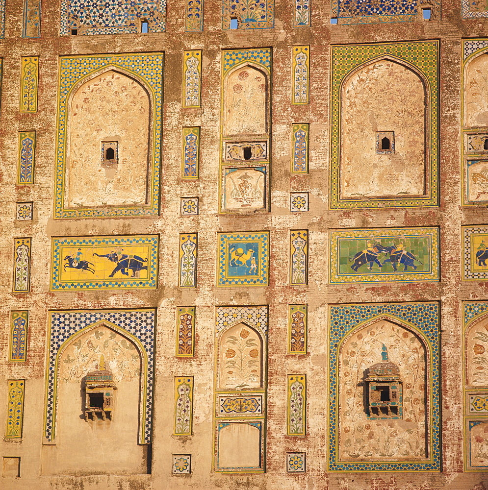 Close-up of decorative tiles on a brick building in Lahore, Pakistan, Asia