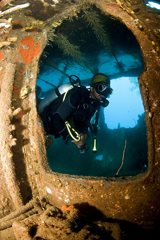 Diver inside the wreck of the Lesleen M freighter, sunk as an artificial reef in 1985 in Anse Cochon Bay, St. Lucia, West Indies, Caribbean, Central America