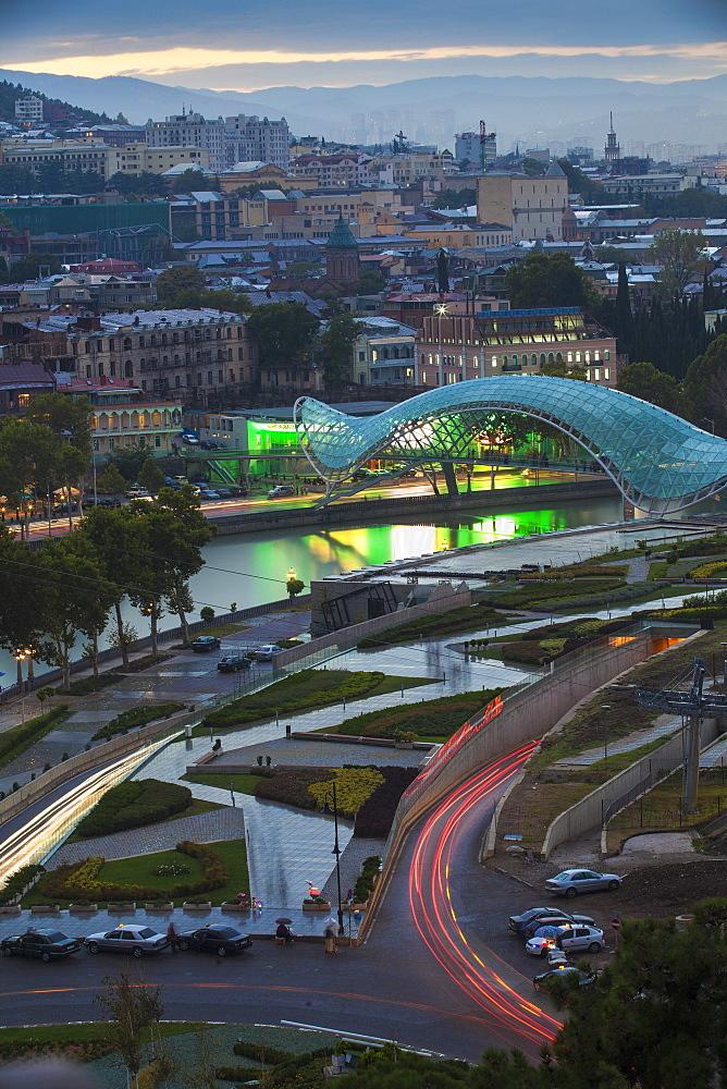 View towards Rike Park and Peace Bridge (Bridge of Peace) over Mtkvari (Kura) River and the city, Tbilisi, Georgia, Caucasus, Central Asia, Asia