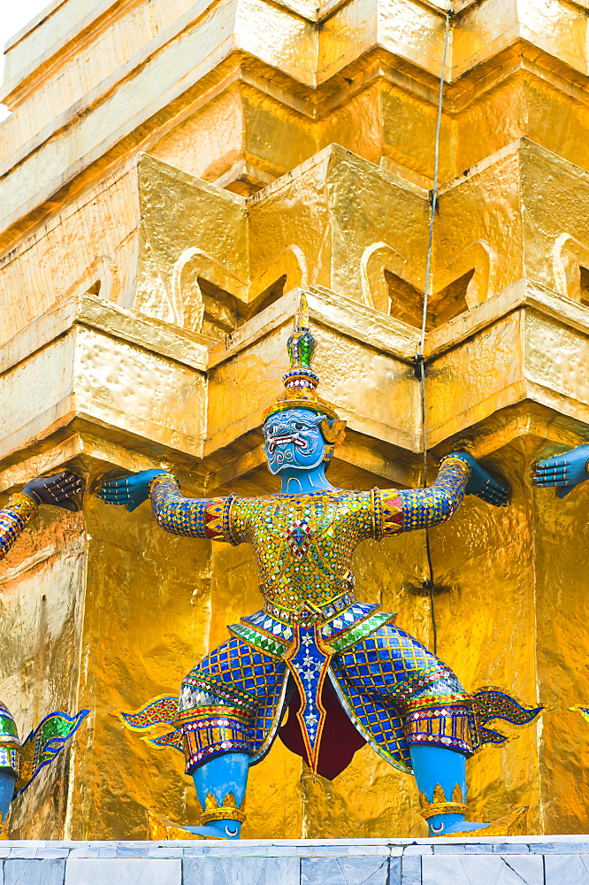 Guardian statues supporting a golden chedi, Grand Palace, Bangkok, Thailand, Southeast Asia, Asia