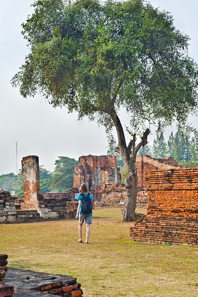 Tourist sightseeing at temple Ruins at Wat Mahathat, Ayutthaya, UNESCO World Heritage Site, Thailand, Southeast Asia