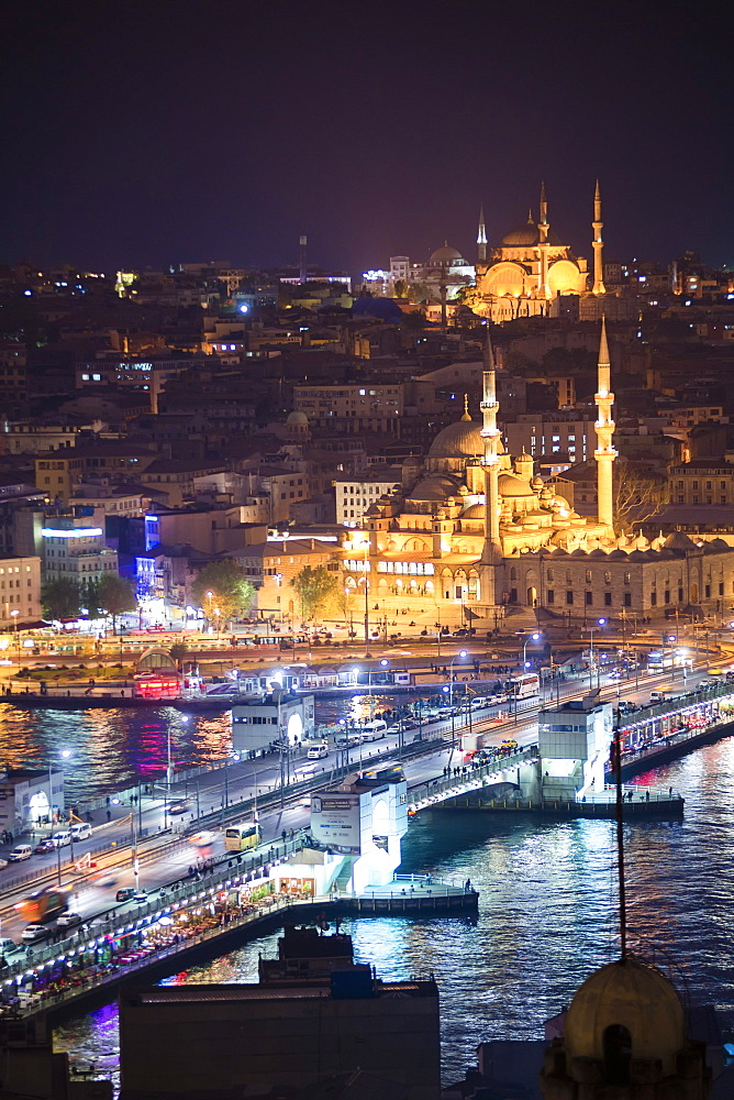 New Mosque (Yeni Cami) and Galata Bridge across Golden Horn at night seen from Galata Tower, Istanbul, Turkey, Europe