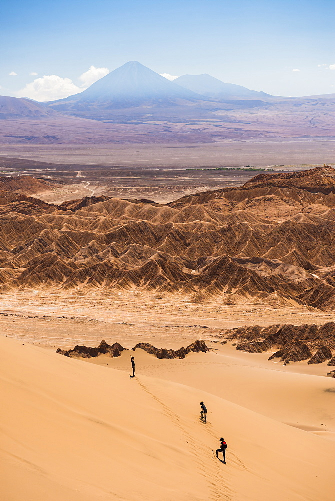 Tourists in sand dunes at Death Valley (Valle de la Muerte), San Pedro de Atacama, Atacama Desert, North Chile, Chile, South America