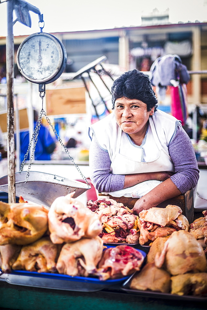 Portrait of Peruvian woman selling meat at San Camilo Market (Mercado San Camilo), Arequipa, Peru, South America
