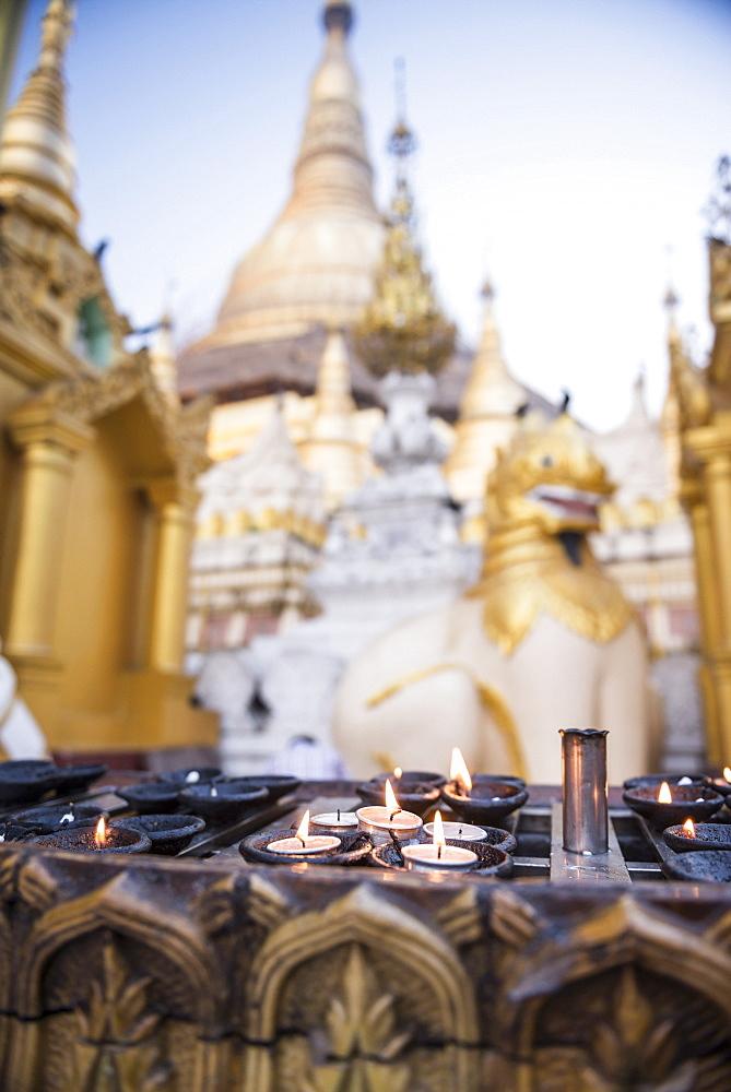 Burning candles at Shwedagon Pagoda (Shwedagon Zedi Daw) (Golden Pagoda), Yangon (Rangoon), Myanmar (Burma), Asia