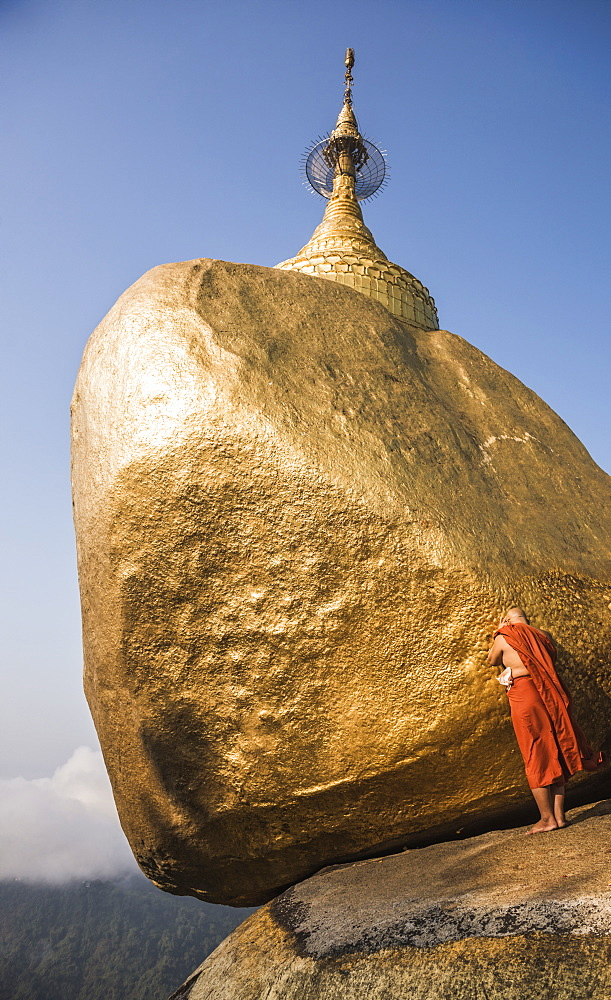 Buddhist Monk praying at Golden Rock (Kyaiktiyo Pagoda), Mon State, Myanmar (Burma), Asia