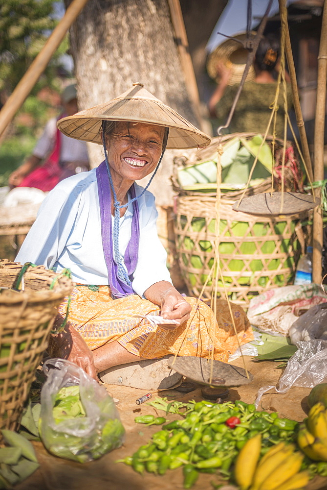 Portrait of a vendor at Ywama Village Market, Inle Lake, Shan State, Myanmar (Burma), Asia
