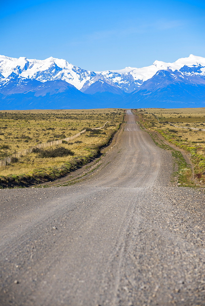 Long straight road to Perito Moreno Glaciar, El Calafate, Patagonia, Argentina, South America
