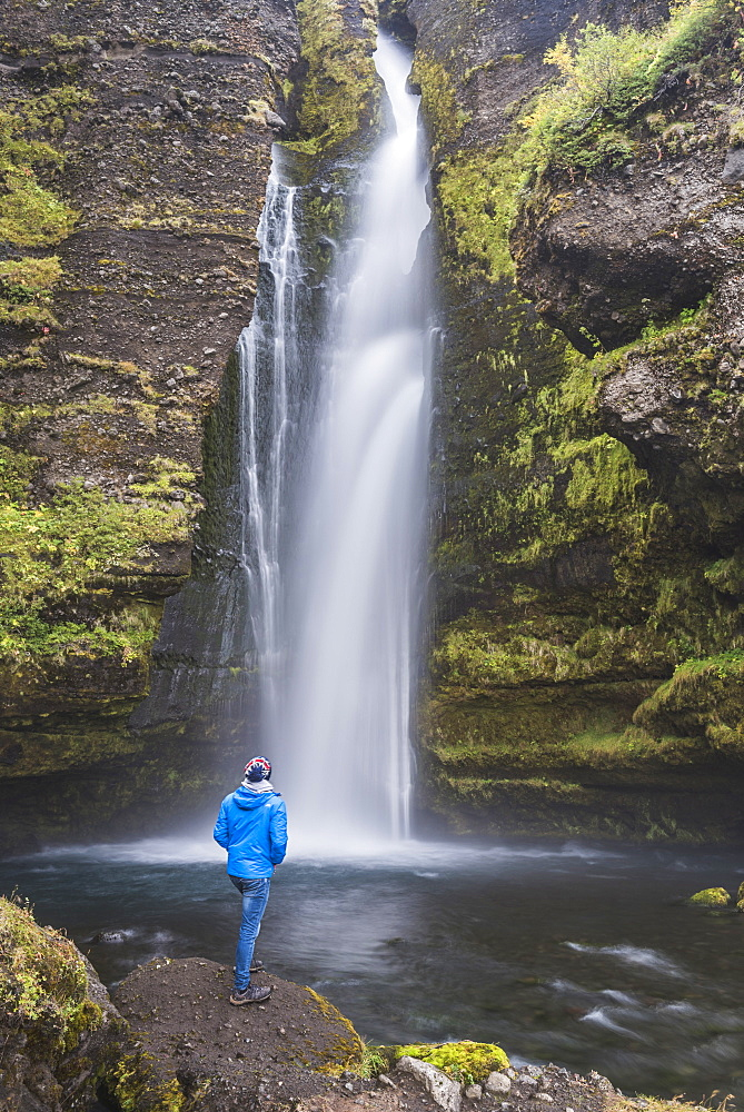 Tourist at Gluggafoss (Window Falls aka Merkjarfoss), a waterfall on the Merkja River, South Iceland (Sudurland), Iceland, Polar Regions