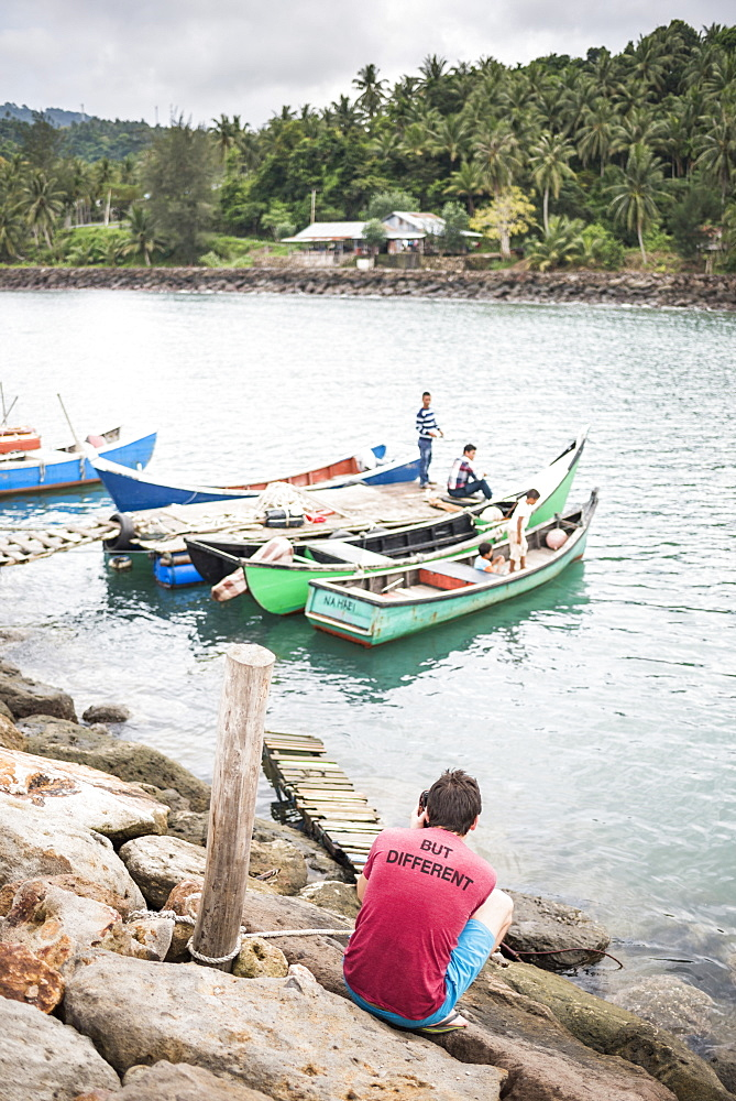 Tourist taking a photo of fishermen on Pulau Weh Island, Aceh Province, Sumatra, Indonesia, Southeast Asia, Asia