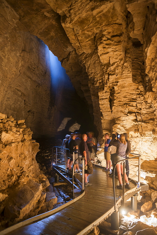 Tourists exploring Waitomo Caves, Waikato Region, North Island, New Zealand, Pacific