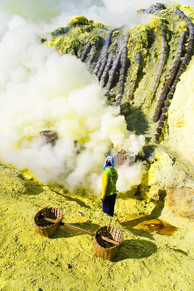 Sulphur worker mining sulphur at the bottom of the crater, Kawah Ijen, Java, Indonesia, Southeast Asia, Asia