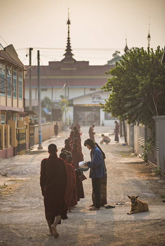 Young novice monks collecting alms at sunset in Pindaya, Shan State, Myanmar (Burma)