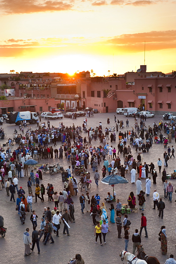 View over people in the Place Djemaa el Fna at sunset, Marrakech, Morocco, North Africa, Africa