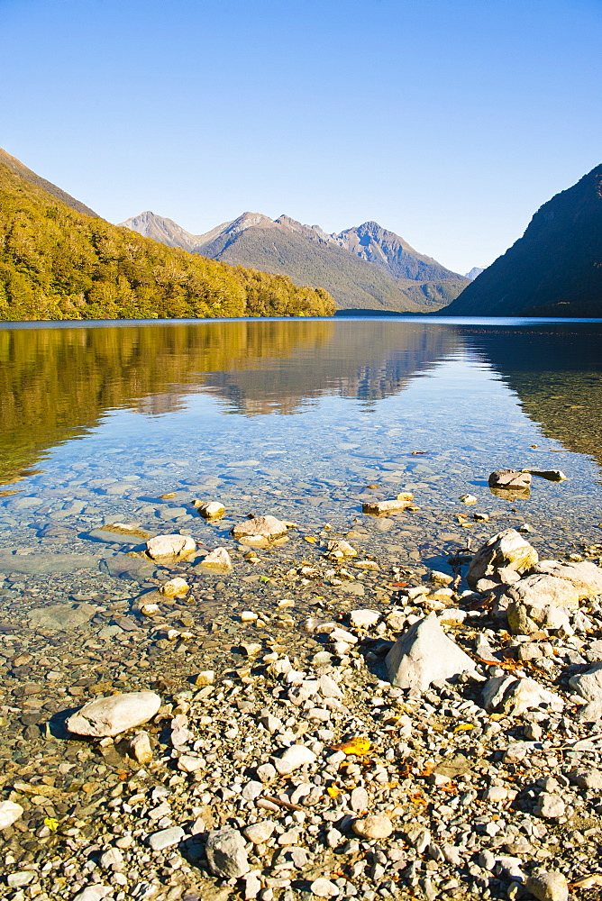 Reflection of mountains in Lake Gunn, Fiordland National Park, UNESCO World Heritage Site, South Island, New Zealand, Pacific