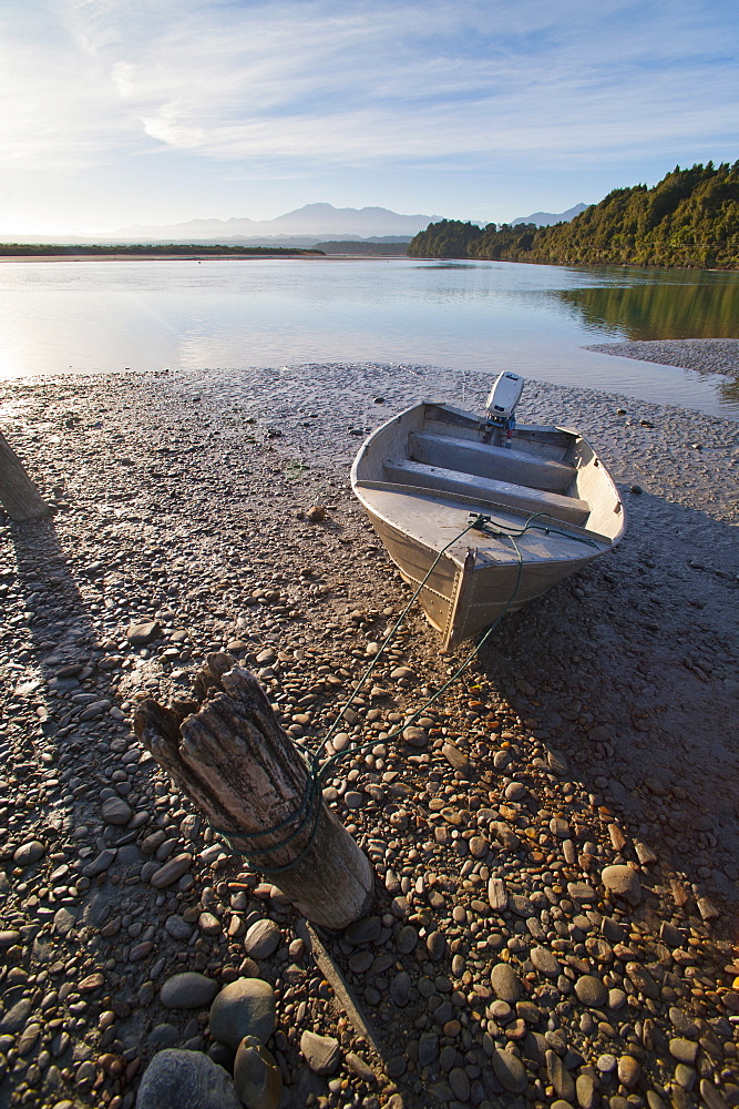 Motor boat at sunrise, Okarito Lagoon, West Coast, South Island, New Zealand, Pacific