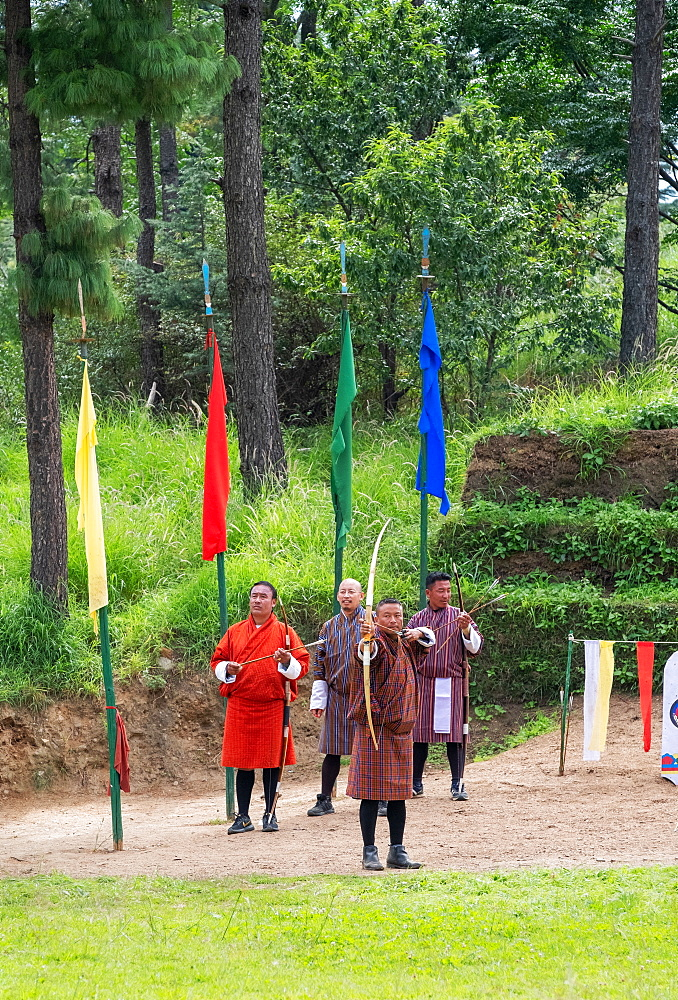 Men compete in an archery competition, Bhutan's national sport.