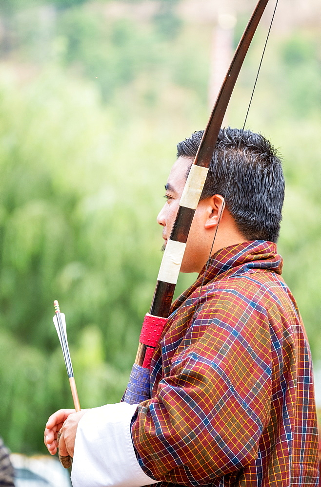Portrait of man at archery competition, Bhutan's national sport, Bhutan, Asia