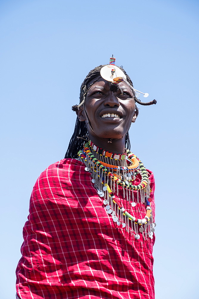 Portrait of a single Masai Mara man wearing traditional jewelry, headpiece and clothes, Masai Mara National Reserve, Kenya, East Africa, Africa - 1111-13