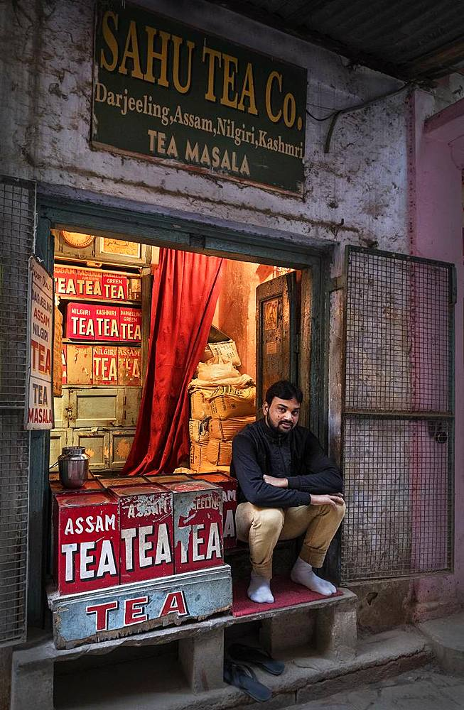 Portrait of an Indian man surrounded by tea tins in his shop, back alleyway near the ghats, Varanasi, Uttar Pradesh, India, Asia - 1111-3