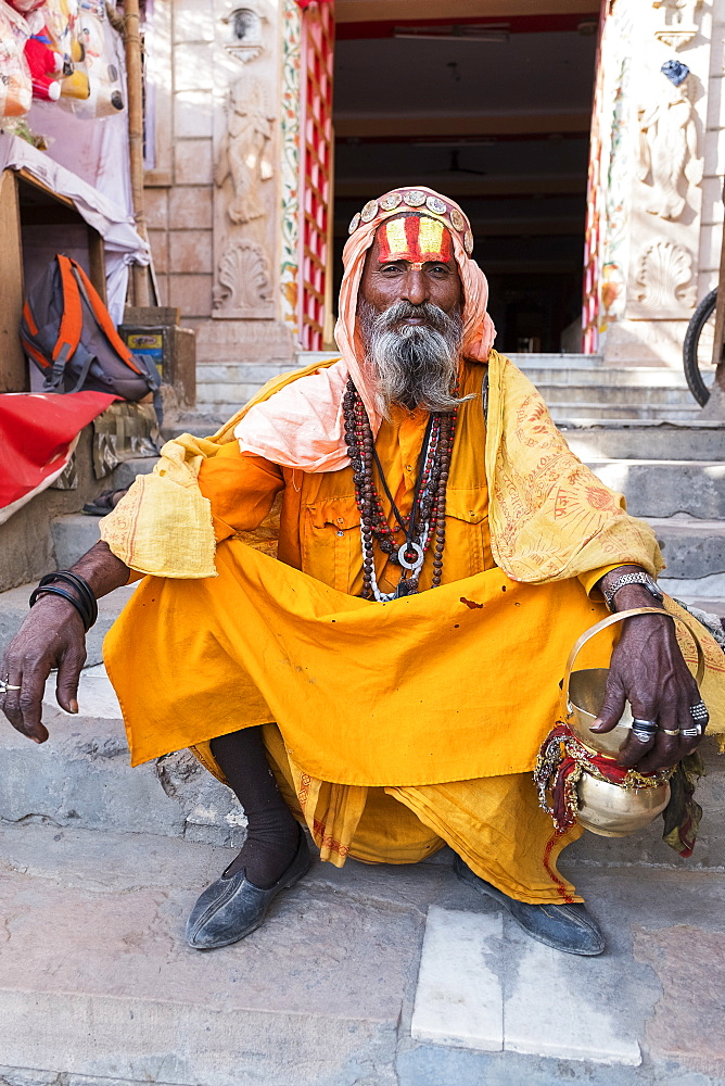 Portrait of Sadhu in orange robes in Pushkar, Rajasthan, India, Asia - 1111-68