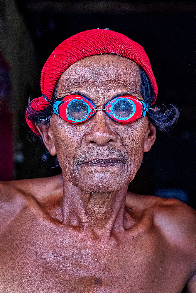 Portrait of a Bajau fisherman wearing crafted wooden goggles from mangrove wood, Togian Island, Indonesia, Southeast Asia, Asia - 1111-87