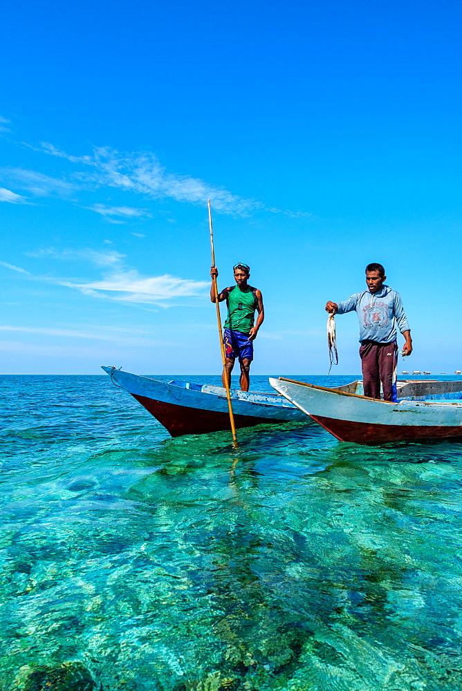 Bajau Fishermen holding an octopus, Togian Islands, Indonesia, Southeast Asia, Asia - 1111-92