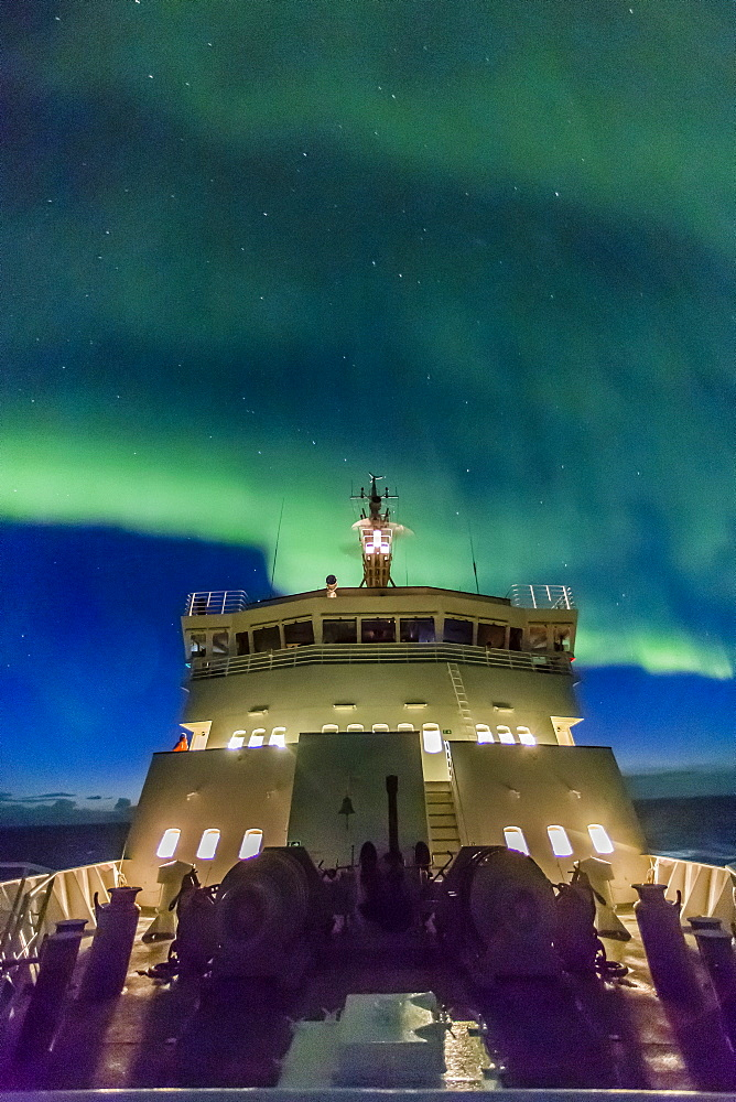 Aurora borealis (Northern Lights) dance above the Lindblad Expeditions ship National Geographic Explorer in Hudson Strait, Nunavut, Canada, North America