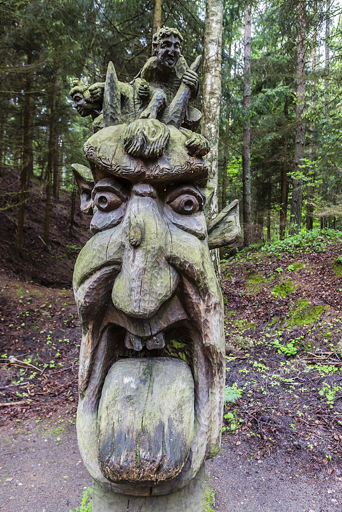 Wood carvings from traditional folklore at The Hill of Witches on the Dano River at the northern tip of the Curonian Spit, Klaipedia, Lithuania, Europe