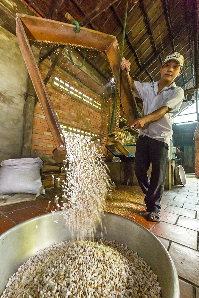 Man making palm sugar rice candy at Cai Be, Vietnam, Indochina, Southeast Asia, Asia