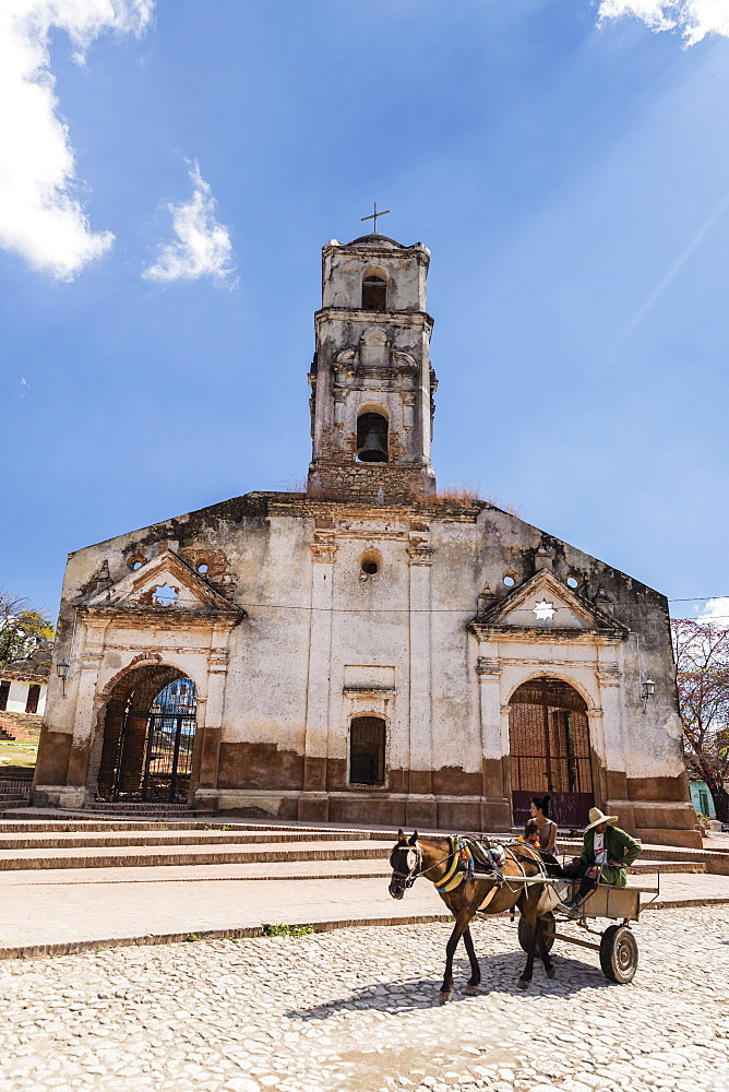 A horse-drawn cart known locally as a coche in the UNESCO World Heritage town of Trinidad, Cuba.