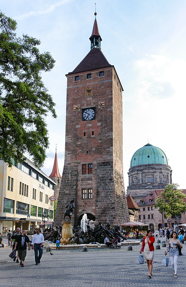 Fountain 'Ehekarussell', 1984 by Juergen Weber, Weisser Turm tower and church of St. Elisabeth, Ludwig Square, Nuremberg, Middle Franconia, Bavaria, Germany