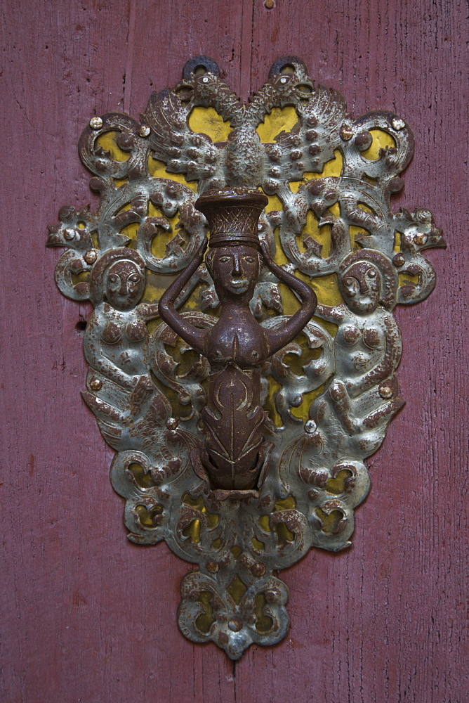 Door ornament on St. George's minster in Altstadt old town, Dinkelsbuehl, Franconia, Bavaria, Germany