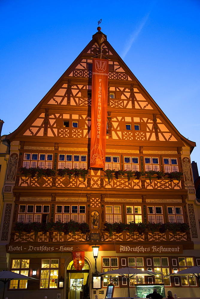 Gasthof Deutsches Haus, restaurant in the old town at dusk, Dinkelsbuehl, Franconia, Bavaria, Germany