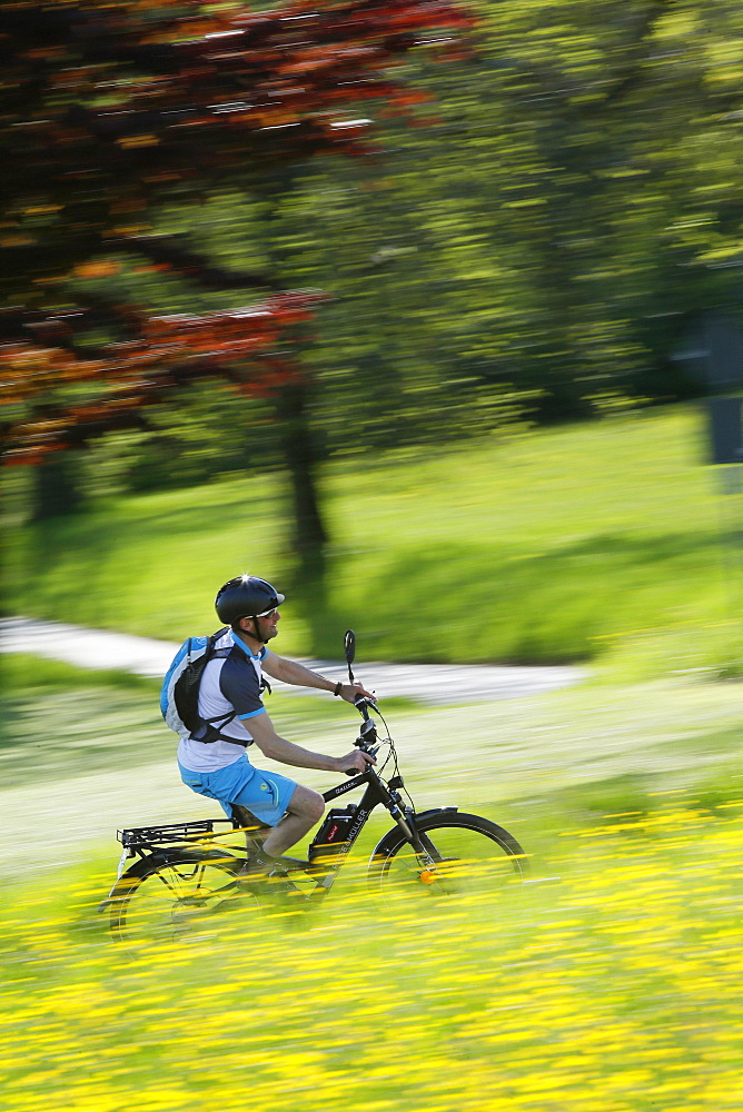 Pedelec cyclist on the way, Upper Bavaria, Germany