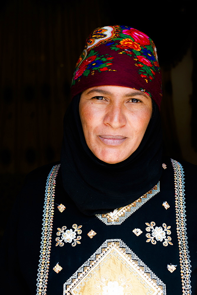 Portrait of a Bedouin woman wearing traditional costume, Wadi Rum, Jordan, Middle East