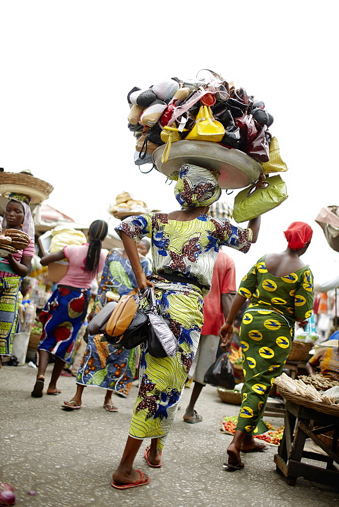 Woman selling handbags at Dantokpa market, Cotonou, Littoral Department, Benin