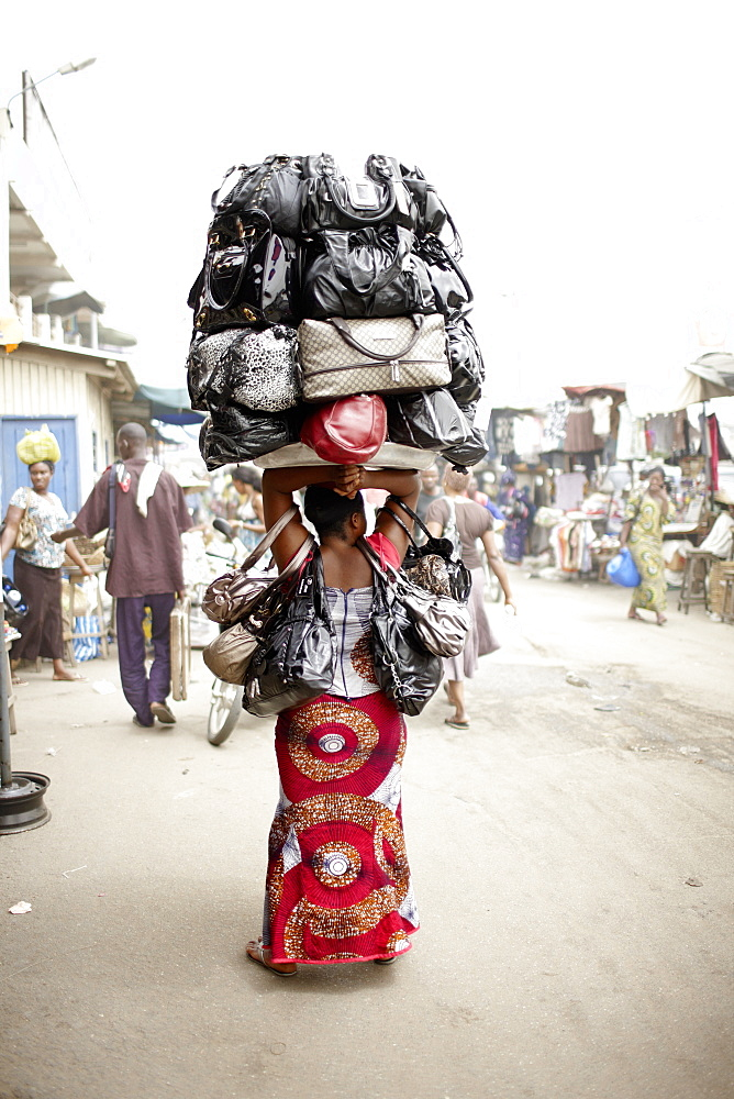 Woman selling handbags at Dantokpa market, Cotonou, Littoral Department, Benin