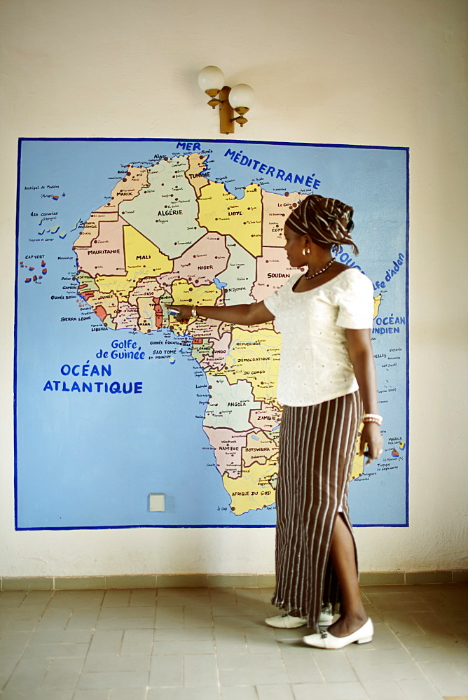 Woman pointing at a map, Grand-Popo, Mono Department, Benin