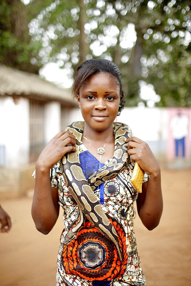 Visitor with snake around her neck, Python temple, Ouidah, Atlantique Department, Benin