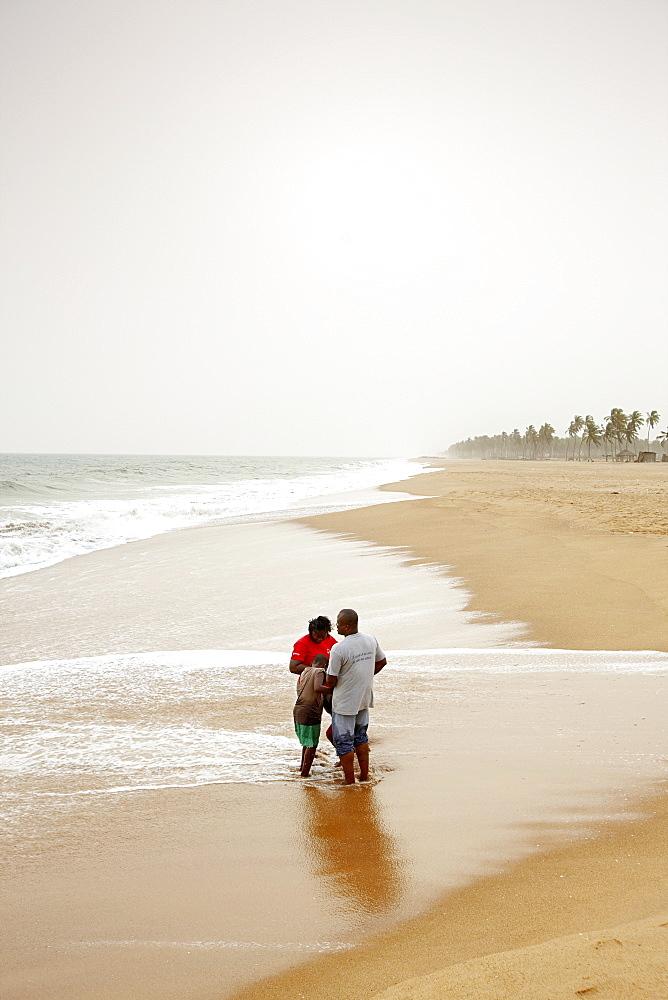 Family standing at beach, Ouidah, Route des Peches, Atlantique Department, Benin